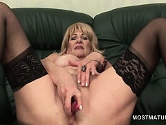 blonde-erotic-mature-lady-nailing-herself-with-sex-toys
