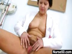 sexy-milf-in-nurse-uniform-stretching-hairy-pussy