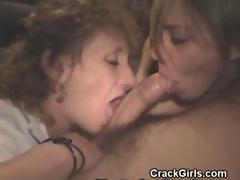pair-of-crack-whores-work-over-cock-together-with-mouths