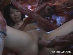 Asian slave sucking monstre's tentacles