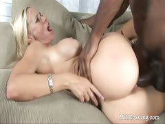 horny-black-dude-fucks-a-hot-milf-on-the-sofa