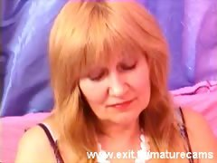 busty-50-years-granny-fingering-on-webcam